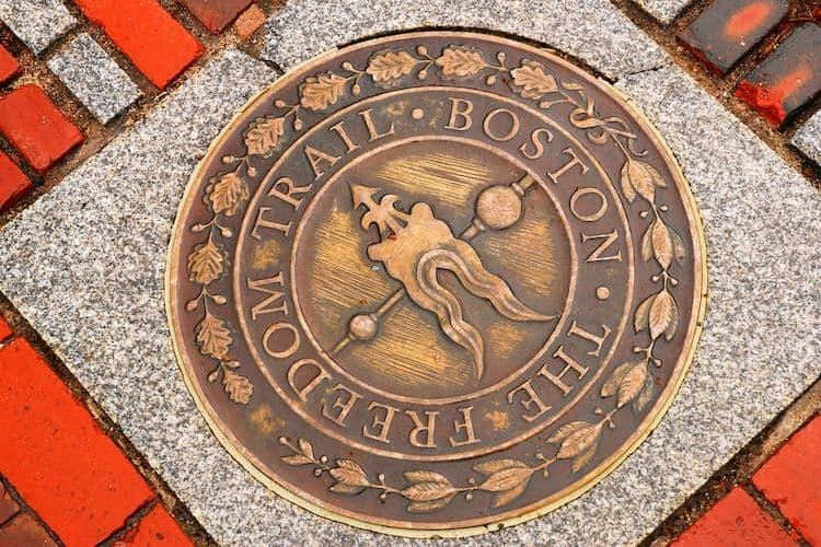 Freedom Trail sign on ground