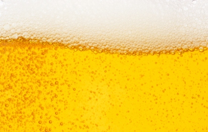 An image of beer liquid with foam at the top