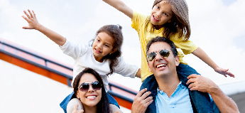 An excited family preps to board an airplane