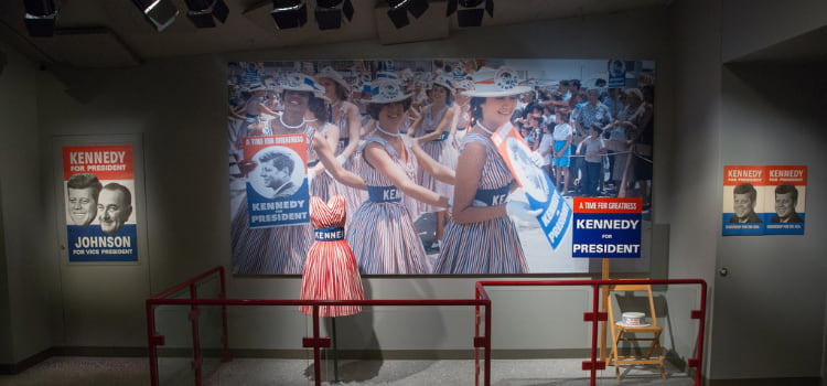 a display with a photo and one of jackie kennedy's dresses at the JFK presidential library and museum